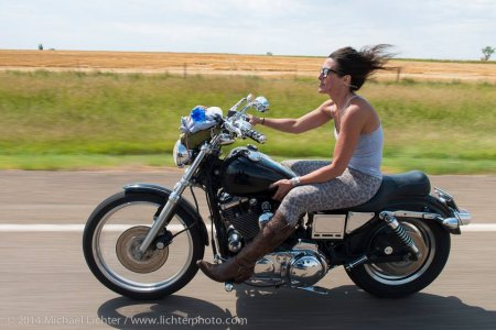 tank top girl on motorbike